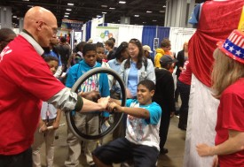Visitors learn about gyroscopic forces in a rotating chair