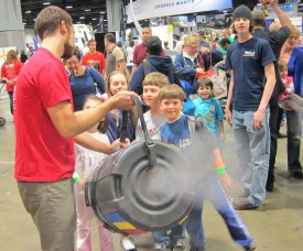 Movement of air through a smoke cannon attracts fascinated crowds