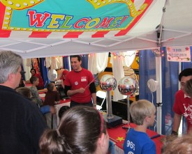 Visitors so excited with the Van de Graaff generators, their hair stood on ends!